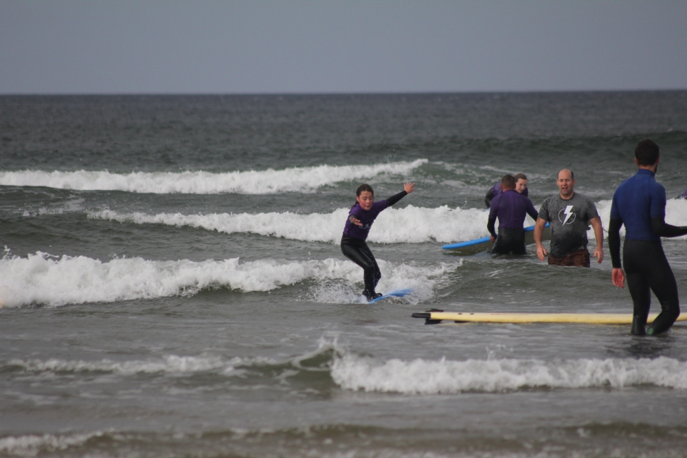 My daughter surfing a wave